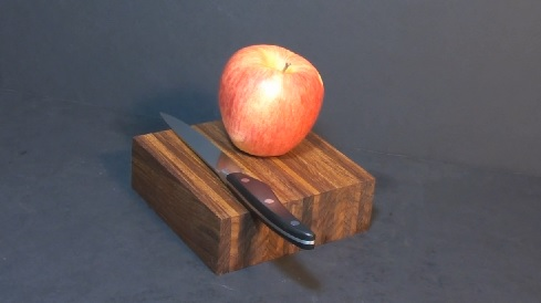 Apple and knife on DIY cutting board