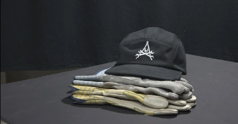 Racing cap with Repairs101 logo and pile of suede palm gloves