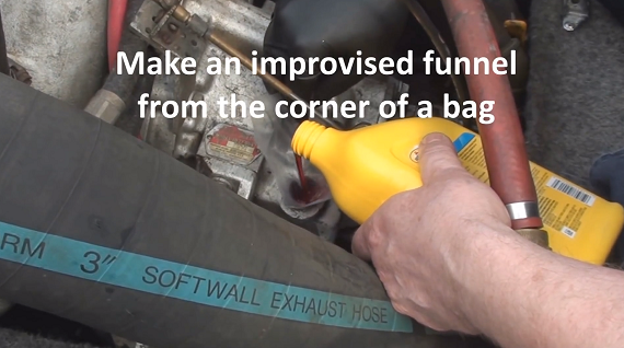 Pouring transmission fluid through a homemade funnel