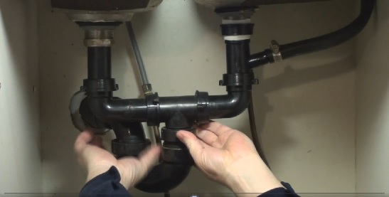 Reassembling the drainage pipes under the kitchen sink