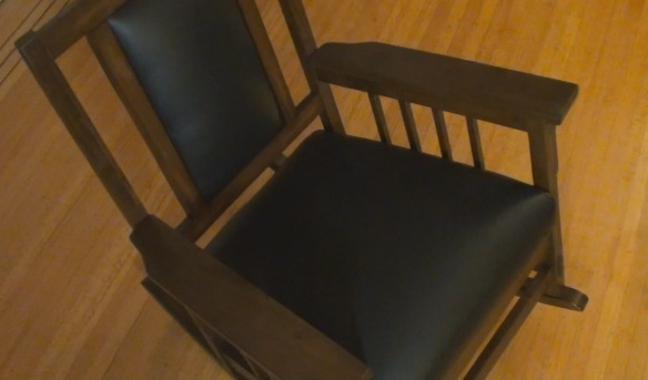 Rocking chair assembled with leather upholstery