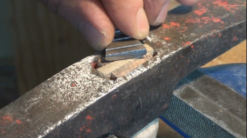 Fitting a steel wedge to hammer handle head