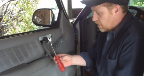 Steve showing an automotive interior door panel removal tool