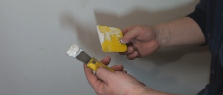Handling spackle with a putty knife and a plastic scraper