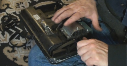 Using a screwdriver to stretch and install drive belt